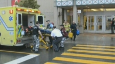 Montreal EMS workers lift a stretcher into an ambulance on Friday, August 10, 2012.