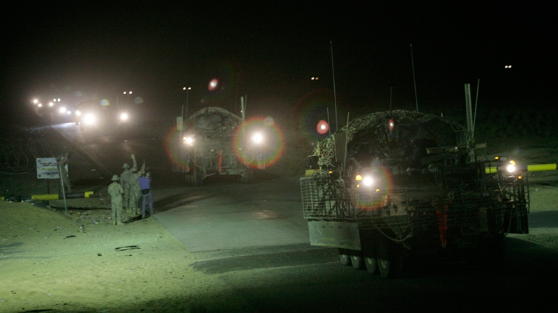 The last in a convoy of U.S. Army Stryker armored vehicles leave Iraq at the Khabari border crossing into Kuwait, Thursday, Aug. 19, 2010. (AP / Maya Alleruzzo)