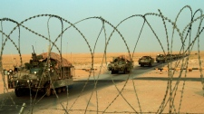 A column of U.S. Army Stryker armored vehicles cross the border from Iraq into Kuwait on Wednesday, Aug. 18, 2010. (AP /  Maya Alleruzzo)