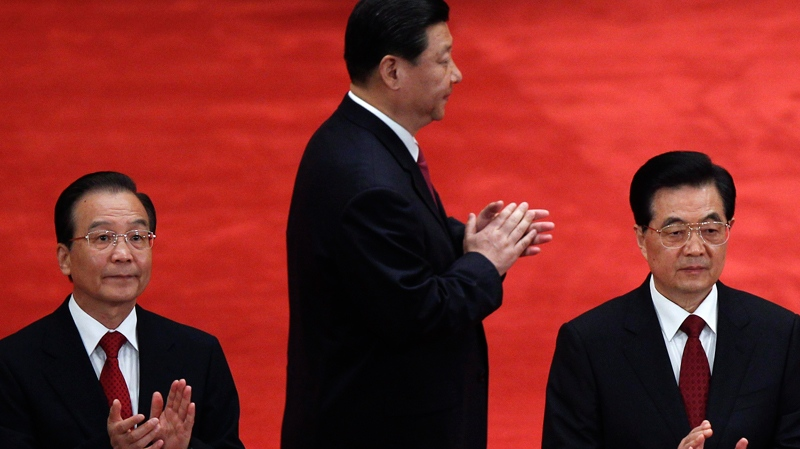 In this photo taken May 4, 2012, Chinese President Hu Jintao, right, Premier Wen Jiabao, left, and Vice President Xi Jinping, clap as they arrive for a conference to celebrate the 90th anniversary of the founding of the Chinese Communist Youth League at the Great Hall of the People in Beijing. (AP / Alexander F. Yuan)