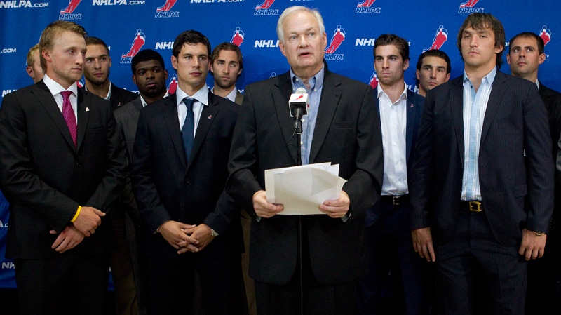 Donald Fehr (centre) Executive Director of the NHLPA stands with NHL players as they speak with the press following collective bargaining talks in Toronto on Tuesday, Aug. 14, 2012. (Chris Young / THE CANADIAN PRESS)