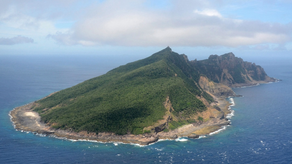 This aerial view shows Uotsuri Island, one of the islands of Senkaku in Japanese and Diaoyu in Chinese, in East China Sea, June 2011. (Kyodo News)