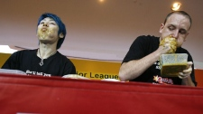 Takeru Kobayashi, of Japan left, and Joey Chestnut of the U.S. are seen during the Major League Eating contest Asia Face-off on Sunday July 27, 2008 in Singapore. (AP Photo/ Wong Maye-E)