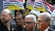 Members of the Fight HST group, Bill Tieleman, left, lead organizer Chris Delaney, second right, and former British Columbia premier Bill Vander Zalm, right, speak to reporters outside B.C. Supreme Court after a judge ruled the anti-HST petition they led was valid in Vancouver, B.C., on Friday August 20, 2010. (CP/Darryl Dyck)