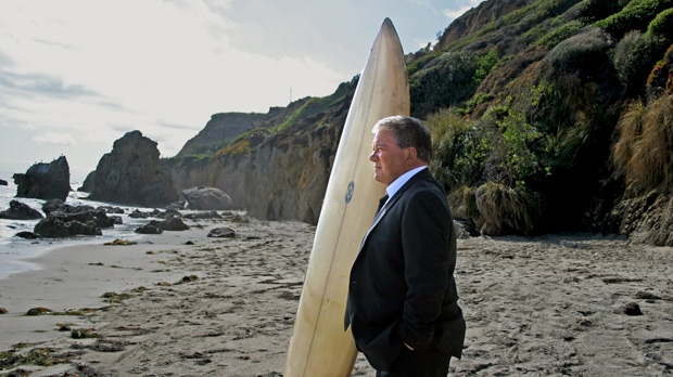 This image released by Priceline shows William Shatner on a beach during a commercial. (AP Photo/Priceline.com, Susan Smith)