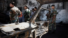Syrian soldiers investigate the scene