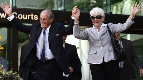 Former British Columbia premier Bill Vander Zalm, left, and his wife Lillian celebrate as they leave B.C. Supreme Court after a judge ruled the anti-HST petition he led was valid in Vancouver, B.C., on Friday, August 20, 2010. (CP/Darryl Dyck)