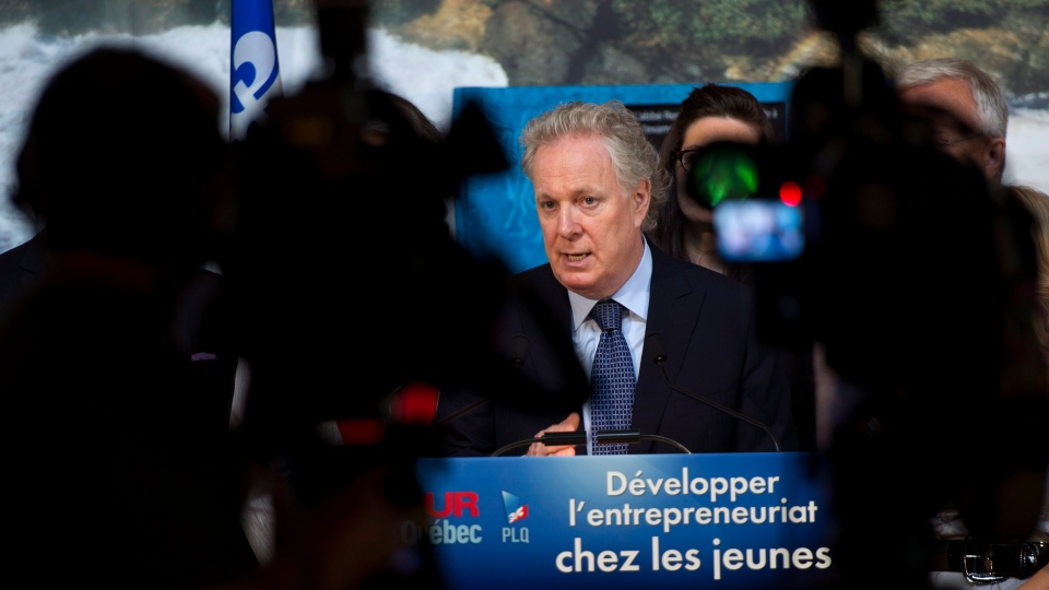 Quebec Premier Jean Charest responds to a question during a news conference Wednesday, August 15, 20