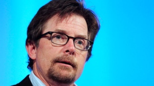 In this June 15, 2012 file photo, Michael J. Fox speaks at the Middlesex Community College Celebrity Forum in Lowell, Mass. (AP Photo/Michael Dwyer)