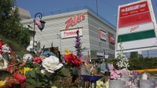 A makeshift memorial sits outside the Algo Centre Mall in Elliot Lake, Ont., on Tuesday, Aug. 14, 20
