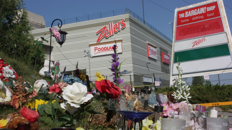 A makeshift memorial sits outside the Algo Centre Mall in Elliot Lake, Ont., on Tuesday, Aug. 14, 2012. (Colin Perkel / THE CANADIAN PRESS)