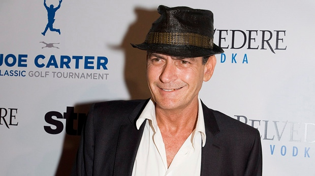 Actor Charlie Sheen stands on the red carpet at the Joe Carter Classic After-Party in Toronto on Wednesday, Aug. 15, 2012. (The Canadian Press/Aaron Vincent Elkaim)