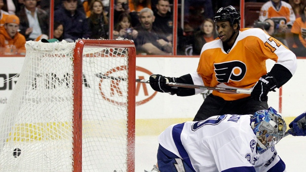 Philadelphia Flyers' Wayne Simmonds scores a goal past Tampa Bay Lightning's Dwayne Roloson in the second period of an NHL game Monday, March 26, 2012, in Philadelphia. (AP Photo/Matt Slocum)