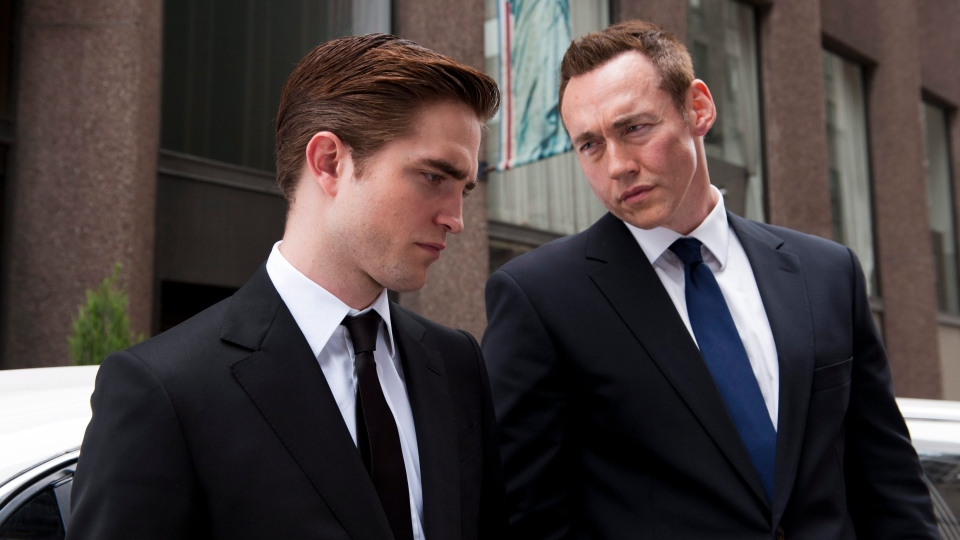 Robert Pattinson, left, and Kevin Durand in a scene from