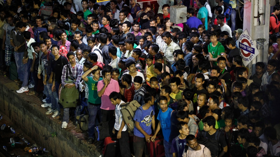 People from India's northeastern states wait to board a special train to go back home, at a train station in Bangalore, India, Thursday, Aug. 16, 2012. (AP / Aijaz Rahi)