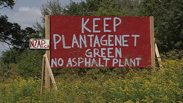 Signs like this have been put up near the site of a proposed asphalt plant near Plantagenet, about 40 minutes east of downtown Ottawa.