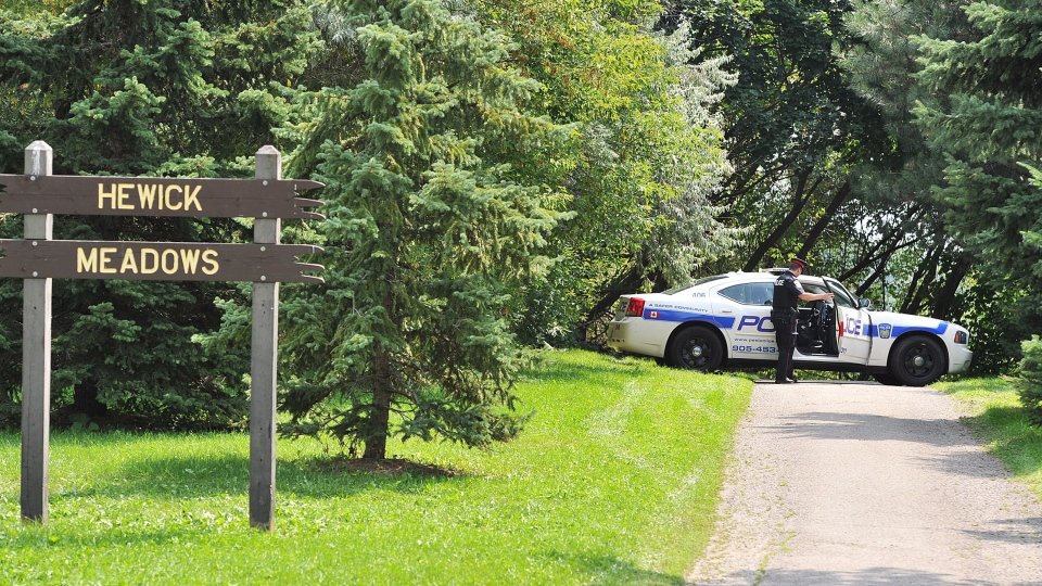 Police block off access to Hewick Meadows Park in Mississauga, Ont., after discovering a female severed head in Hewick Meadows Park in Mississauga, Ont., after police discovered a female severed head on Thursday Aug.16, 2012.  (Aaron Vincent Elkaim /  THE CANADIAN PRESS)