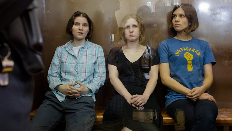 Feminist punk group Pussy Riot members, Nadezhda Tolokonnikova, right, Maria Alekhina, center, and Yekaterina Samutsevich, sit in a glass cage at a court room in Moscow, Russia, Friday, Aug. 17, 2012. (AP / Misha Japaridze)