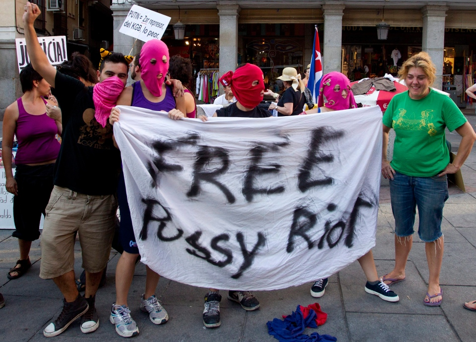 Demonstrators hold a banner in support of the Russian punk group Pussy Riot during a protest outside Spain's Foreign Office in Madrid Thursday Aug. 16, 2012. (AP Photo/Paul White)
