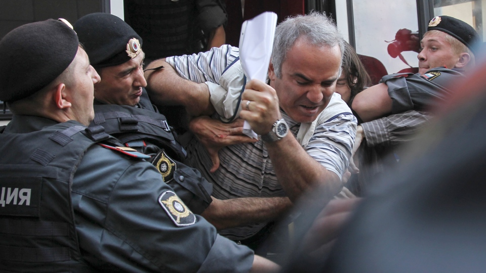 Police officers detain former world chess champion Garry Kasparov, a leading opposition activist, outside the court where a trial of the feminist punk group Pussy Riot is held, in Moscow, Friday, Aug. 17, 2012. (AP / Lisa Kessler)