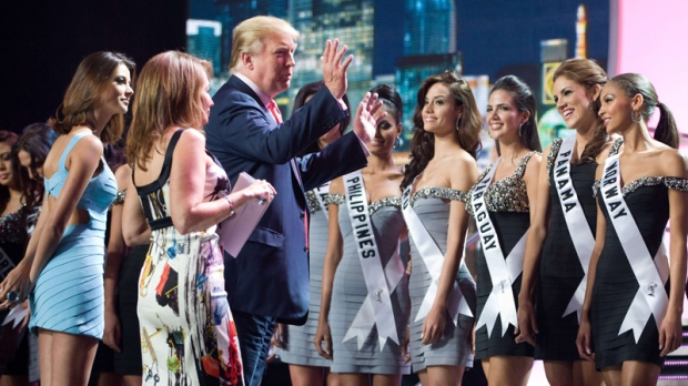 Co-owner of the Miss Universe Pageant, Donald J. Trump, talks with contestants at Mandalay Bay Hotel and Casino in Las Vegas, Nev. on Sunday, Aug. 22, 2010. (AP / Miss Universe Organization, Darrren Decker)