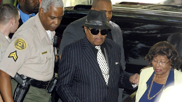 Michael Jackson's father, Joseph, second from left, and mother Katherine Jackson  arrive for a hearing for Dr. Conrad Murray at the Los Angeles Superior Court on Monday, Aug. 23, 2010, in Los Angeles. A judge says a preliminary hearing for the doctor charged in Michael Jackson's death will begin Jan. 4. (AP / Damian Dovarganes)