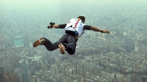 This image provided by the Euro-Newsroom agency shows Austrian base jumper Felix Baumgartner leaping off the Taipei 101 skyscraper in Taiwan Tuesday Dec. 11, 2007. (AP / Joerg Mitter, Euro-Newsroom)