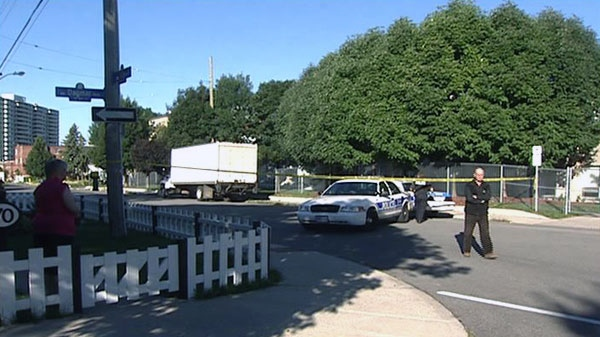 Police tape blocks off an intersection at Alice and St. Charles Streets in Vanier as investigators probe the city's ninth homicide of the year, Friday, Aug. 20, 2010.