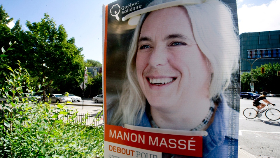 A poster of Quebec Solidaire candidate Manon Masse is seen in Montreal, Saturday, Aug. 18, 2012. (Paul Chiasson / THE CANADIAN PRESS)