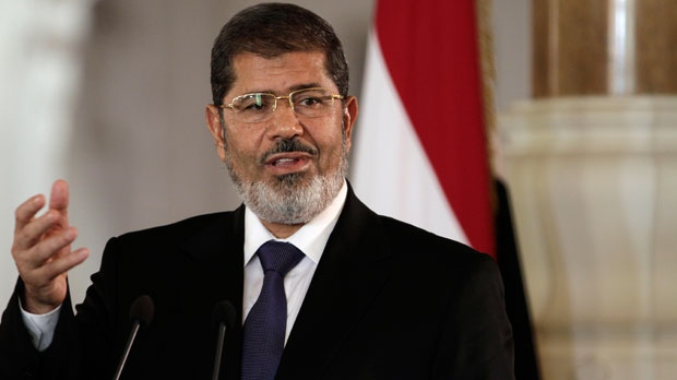 Egyptian President Mohammed Morsi speaks to reporters during a joint news conference with Tunisian President Moncef Marzouki on Friday, July 13, 2012. (AP / Maya Alleruzzo)
