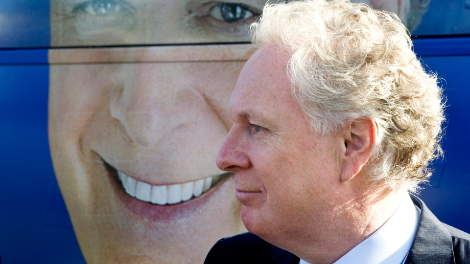 Quebec Premier Jean Charest arrives at a news conference in Laval, Que., Saturday, Aug.18, 2012. (Paul Chiasson / THE CANADIAN PRESS)
