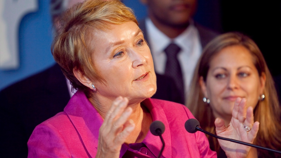 PQ leader Pauline Marois gestures during a news conference in Quebec City, Friday, Aug. 17, 2012. (Francis Vachon / THE CANADIAN PRESS)
