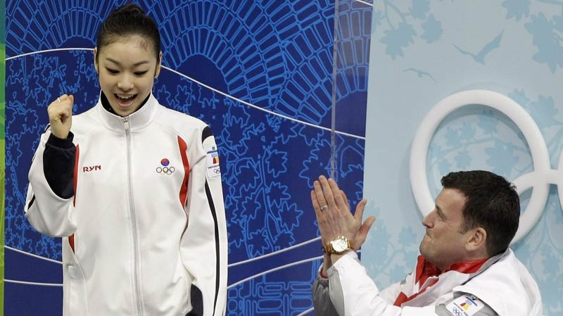 South Korea's Kim Yu-na and Brian Orser following her short program during women's figure skating at the Vancouver 2010 Olympics in Vancouver, British Columbia on Feb. 23, 2010. (AP Photo/Amy Sancetta, File)