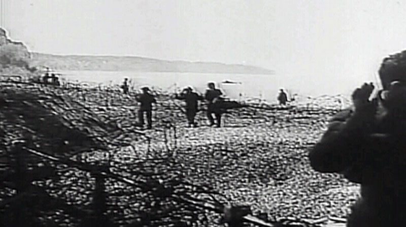 Soldiers storm the French coastline in Dieppe, France, in this photo from video taken in 1942.