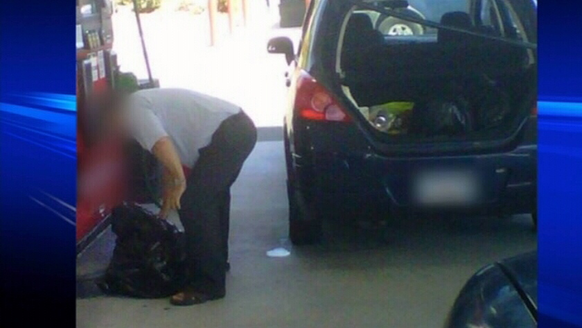 This image, taken at a gas station in Bellingham, Wash., purports to show a man from British Columbia filling garbage bags with gasoline.