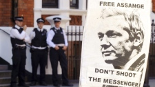 A pro-Assange placard is seen outside the Embassy of Ecuador in central London on Aug. 18, 2012.
