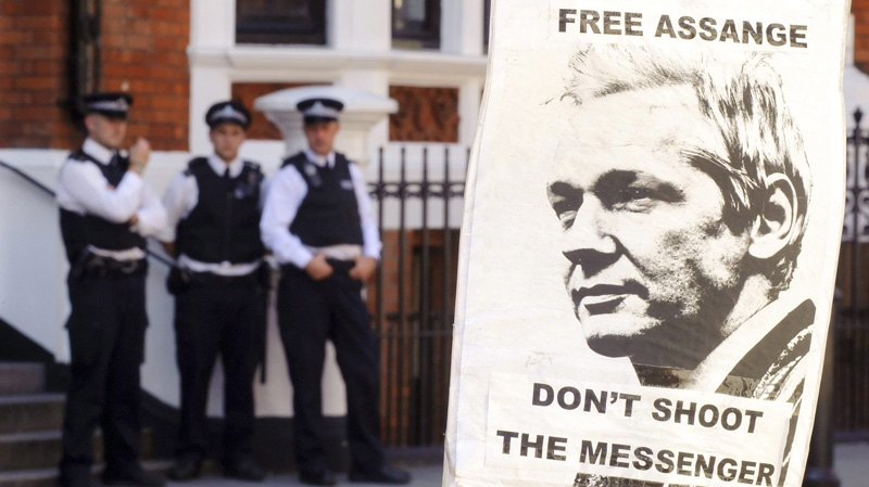 A pro-Julian Assange placard is seen outside the Embassy of Ecuador, in central London, Saturday August 18, 2012, where Wikileaks founder Julian Assange is claiming asylum in an effort to avoid extradition to Sweden. (AP Photo / Dominic Lipinski/PA)
