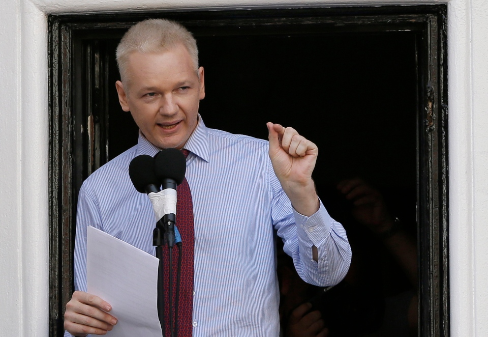 Julian Assange, founder of WikiLeaks makes a statement from a balcony of the Equador Embassy in London on Sunday, Aug. 19, 2012.  (AP / Kirsty Wigglesworth)
