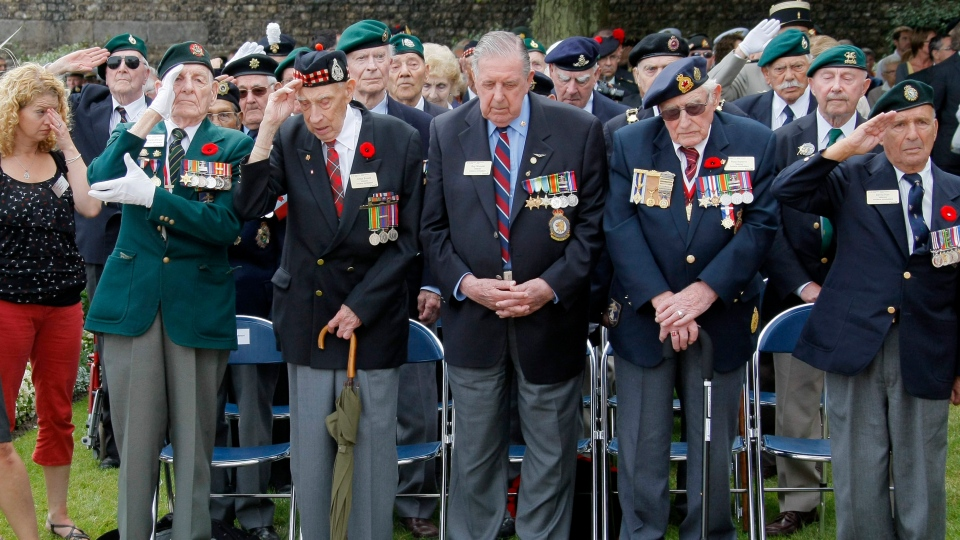 Left to right, Dieppe veterans Fred Engelbretch, 92, Arthur Rossel, 92 of Brampton, Ont., Roy Wozniak, 93, Russ Burrows, 93 of Picton, Ont., and David Lloyd Hart, 95 are seen during the commemorations to honour Allied soldiers killed 70 years ago in a failed World War II invasion, in Dieppe, northern France, Sunday, Aug. 19, 2012. (AP / Michel Spingler)