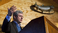 Prime Minister Stephen Harper delivers an announcement in Churchill, Man., on the second day of his five day northern tour on Tuesday Aug. 24, 2010. (Sean Kilpatrick / THE CANADIAN PRESS)