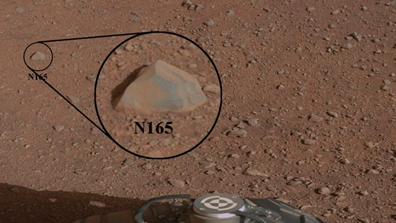 A close-up view of a Martian rock that the NASA rover Curiosity zapped at with its laser instrument is seen in this image provided by NASA, Sunday, Aug. 19, 2012. (AP / NASA)