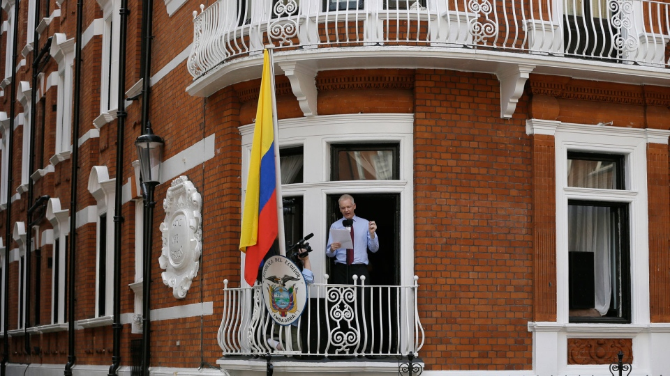 Julian Assange, founder of WikiLeaks makes a statement from a balcony of the Equador Embassy in London, Sunday, Aug. 19, 2012. (AP / Kirsty Wigglesworth)