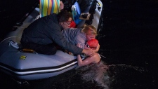 Annaleise Carr is embraced after she officially finished her record breaking swim