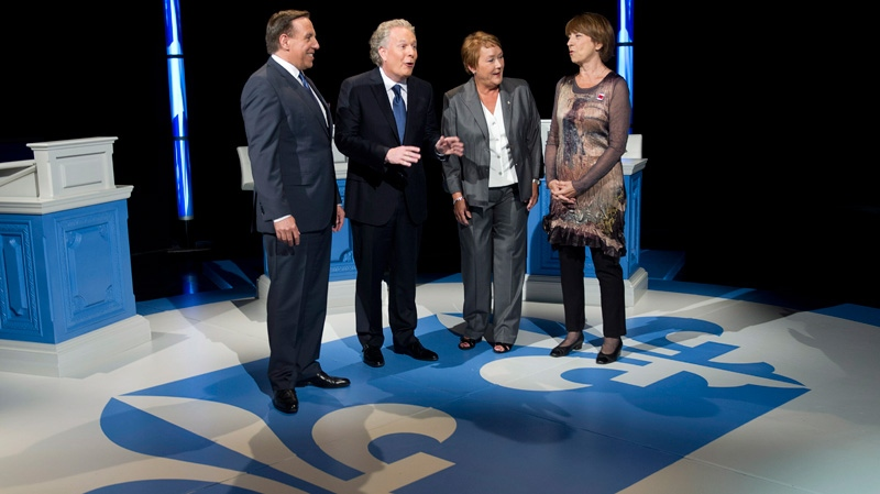 Coalition Avenir Quebec leader Francois Legault, Quebec Premier Jean Charest, PQ leader Pauline Marois and Quebec Solidaire co-leader Francoise David, left to right, chat on the set prior to the leaders debate in Montreal Sunday, August 19, 2012. (Paul Chiasson / THE CANADIAN PRESS)