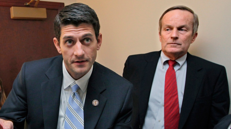 Missouri Congressman Todd Akin, right, listens to House Budget Committee Chairman Paul Ryan, R-Wis., before a news conference on Ryan's budget agenda, on Capitol Hill in Washington Tuesday, April 5, 2011. (AP / J. Scott Applewhite)