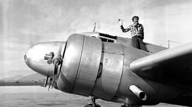 In a March 10, 1937 file photo American aviatrix Amelia Earhart waves from the Electra before taking off from Los Angeles, Ca., on March 10, 1937.  (AP Photo, file)