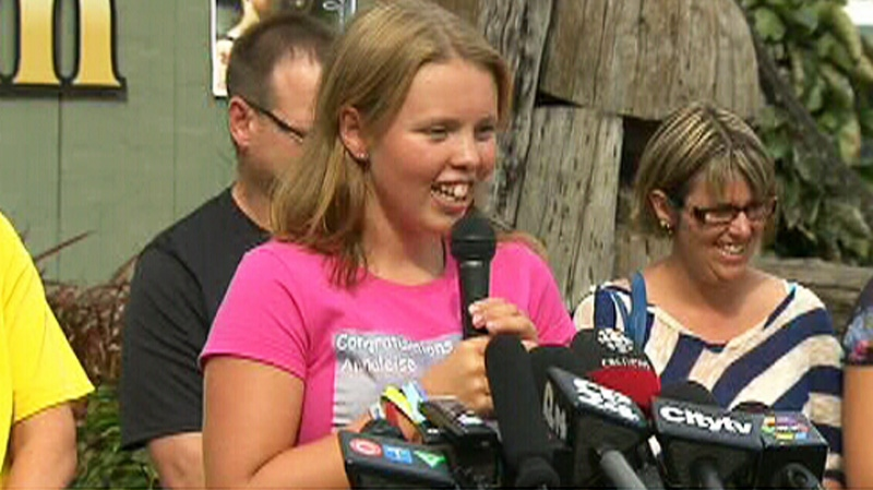 Annaleise Carr speaks to the media in Port Dover, Ont., Monday, Aug. 20, 2012.