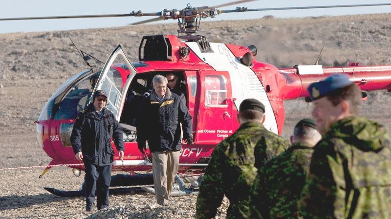 Prime Minister Stephen Harper arrives by helicopter to take part in training exercises during Operation Nanook in Resolute, Nunavut on the third day of his five-day northern tour to Canada's Arctic on Wednesday Aug. 25, 2010. (Sean Kilpatrick / THE CANADIAN PRESS)