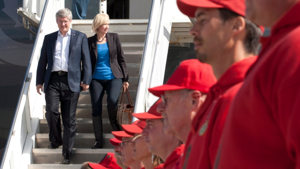 Prime Minister Stephen Harper and his wife Laureen are greeted by members of the Canadian Rangers as they arrive in Whitehorse,Yukon Monday Aug. 20, 2012. (Adrian Wyld / THE CANADIAN PRESS/)