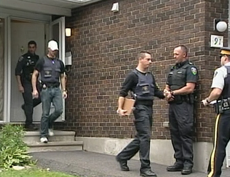 RCMP officers conduct a raid as part of a terror investigation in Esterlawn Private in Ottawa's west end, Wednesday, Aug. 25, 2010.